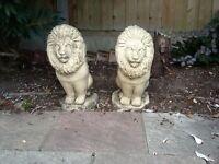 PAIR OF STONE LION GARDEN ORNAMENTS