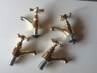 Set of gold plated bath and sink taps