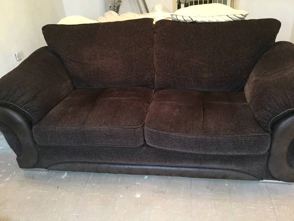 3 and 2 dark brown sofa with tags still