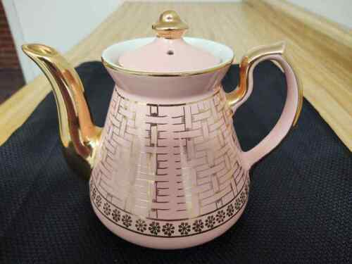 Hall pink teapot 6 cup basket weave gold and decalled.