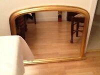 Mirror, over fireplace, 3' across base. Antique gold, excellent condition. Buyer collects.
