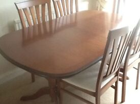 Dining table and 6 chairs. Morris furniture in mahogany.