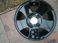Black 14 inch ford alloy wheels