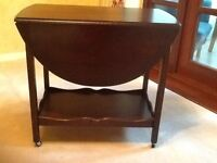 Mahogany tea trolley, doubles as a small table with extending shelf for serving and cutlery draw.