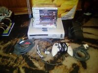 xbox 360 60GB with 12 games 1 pads mic