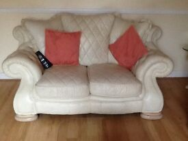 Three and two seater cream leather suite