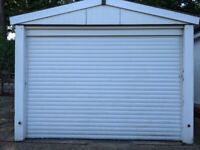 Motorized Garage Door (white) with two Remote Key fobs.