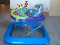 Baby walker with removable battery operated musical &a toy console in excellent condition