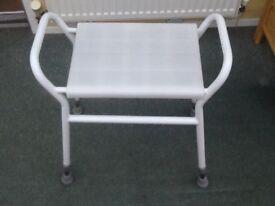 White adjustable shower seat