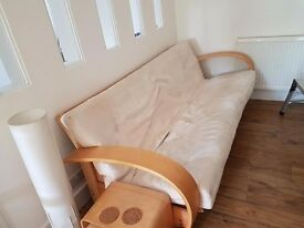 Beautiful laminated wooden three seater double futon
