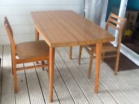 Formica top table and 2 chairs. Only £25F