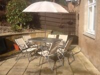 8 piece/ 6 chairs and table and brolly