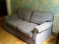 Small marks and spencer light blue sofa