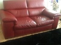 2red Italian leather sofas
