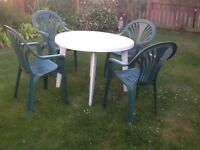 1 garden table and 4 chairs. All in good order and have been stored in the garage
