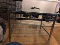 Glass furniture, table X4 chairs, tv unit, 2 small glass tables and a corner table