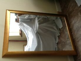 Large WALL MIRROR with gold coloured wooden frame. Perfect condition