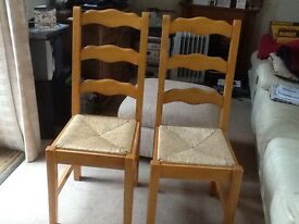 Pair of solid pine chairs with rush seats