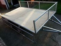 8 X 5 twin axle trailer with drop down side and rear.