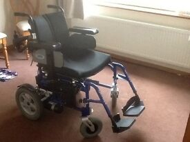 Electric wheelchair carer operated. Includes battery, and charger