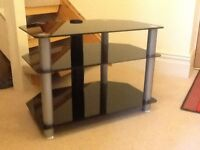 Glass and chrome T.V. Stand