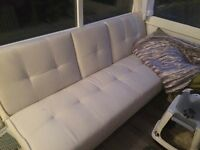 Cream faux leather sofa bed and cinema/Playroom sofa