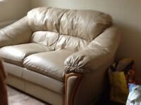 Leather two seater settee/ sofa cream