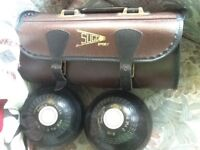 Pair of bowls in leather bowling bag with carrying handle