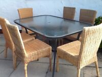 Glass top garden dining table and six wicker chairsi, just reduced!