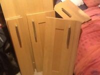 Approximately a dozen various size solid wood wickes kitchen unit doors
