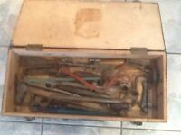 Vintage tools in wooden box.