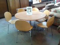 Large circular meeting room table with 6 chairs