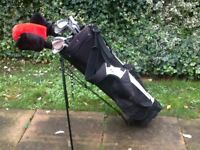 Set of golf clubs, bag and balls