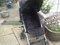 Mamas and papas Buggy black and white in colour good condition with hood