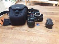 Nikon D D3100 14.2MP Digital SLR Camera - Black (Kit w/ VR 18-55mm Lens)