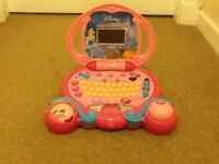 Disney princess lap top with 3 toy CDs.