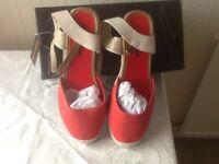 Red wedge heeled espadrilles