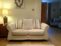 2x2 seater settees and 1 cuddle chair for sale. Cream material. Very good condition. 3 years old.