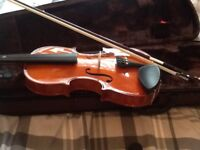 3/4 sized violin and bow with case in excellent condition.