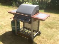 BBQ grill with full gas bottle