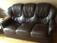 Brown real leather 3 piece suite and two reclining chairs.