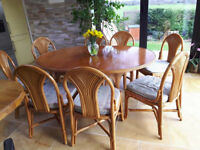 """Dining table and 8 chairs 122cm or 4' in diameter, and 168cm or 5'8"""" when extended."""