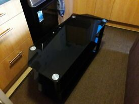TV Stand. Heavy black glass and chrome 3 tier Tv stand