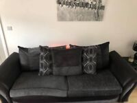 Four seater fabric sofa and foot stool