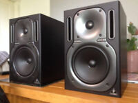 Pair of Behringer Truth B2030A's. Active studio monitors.