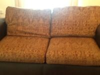 Four seater sofa for sale. Excellent condition. Part leather and material.