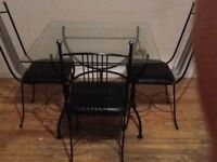 Glass dining table with 4 chairs. Good Condition