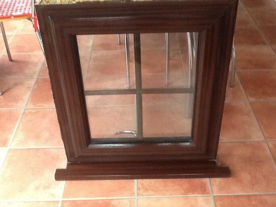 Brown woodgrain rehow UPVC window