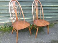 Pair of Ercol Swan back chairs