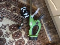 Cordless hedge trimmer with charger and case for blade full working order